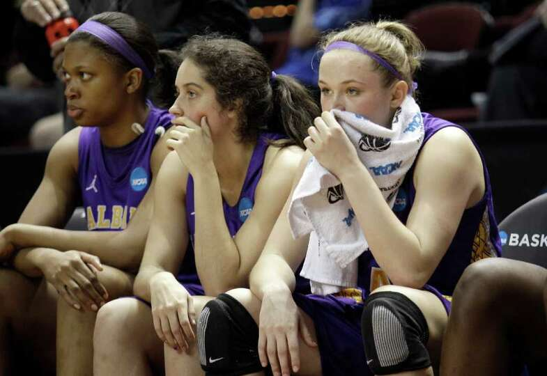 Albany's Sarah Royals, right, Lindsey Lowrie, center, and Keyana Williams, left, sit on the bench du