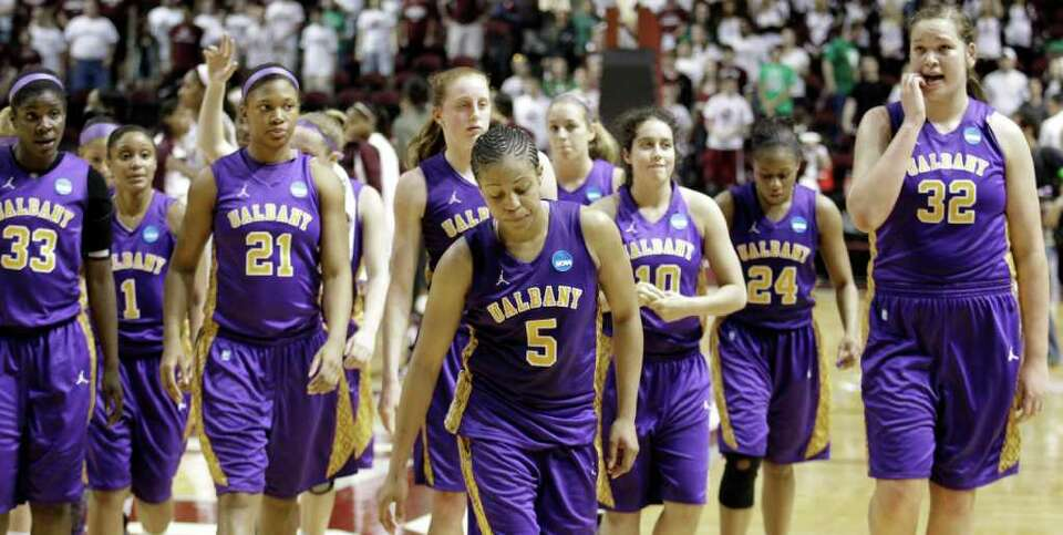 Albany players leave the court after losing to Texas A&M in an NCAA tournament first-round colle