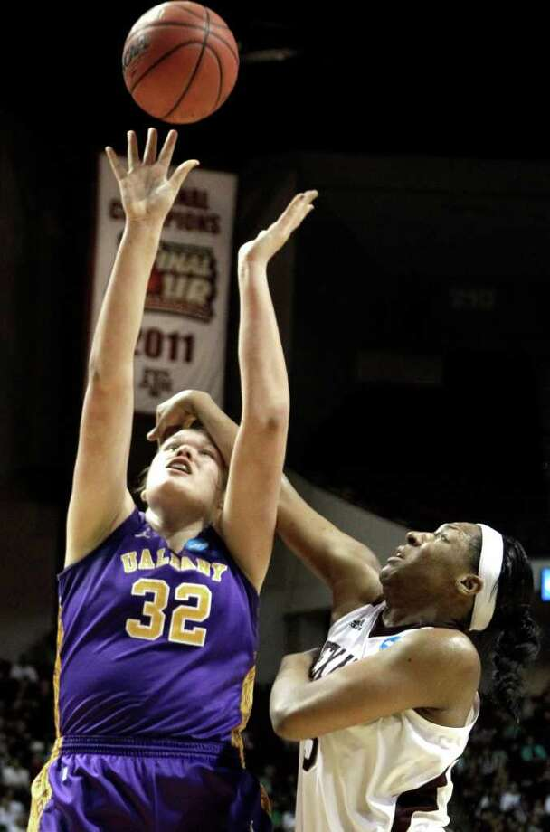 Albany's Megan Craig (32) is fouled by Texas A&M's Kelsey Bone (3) during the second half of an NCAA tournament first-round college basketball game on Saturday, March 17, 2012, in College Station, Texas. Texas A&M defeated Albany 69-47.  (AP Photo/David J. Phillip) Photo: David J. Phillip