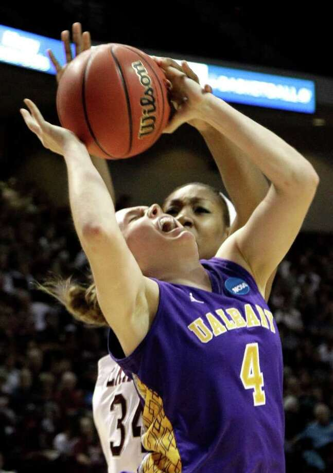 Albany's Sarah Royals (4) is fouled by Texas A&M's Karla Gilbert (34) during the second half of an NCAA tournament first-round college basketball game on Saturday, March 17, 2012, in College Station, Texas. Texas A&M defeated Albany 69-47.  (AP Photo/David J. Phillip) Photo: David J. Phillip