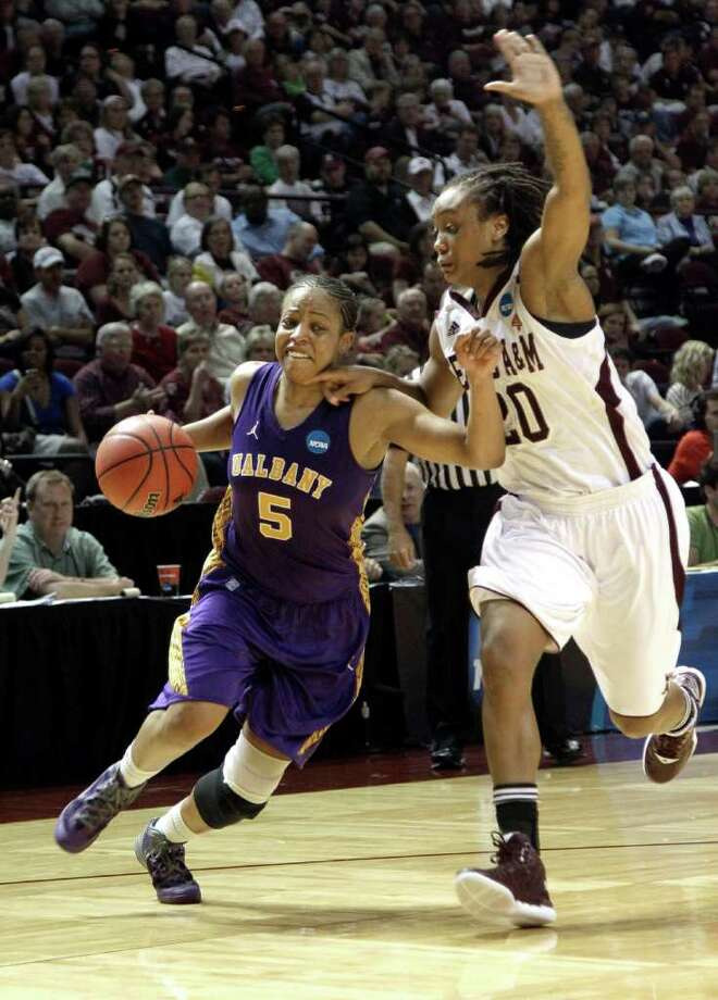 Albany's Ebone Henry (5) is fouled by Texas A&M's Tyra White (20) during the second half of an NCAA tournament first-round college basketball game on Saturday, March 17, 2012, in College Station, Texas. Texas A&M defeated Albany 69-47.  (AP Photo/David J. Phillip) Photo: David J. Phillip