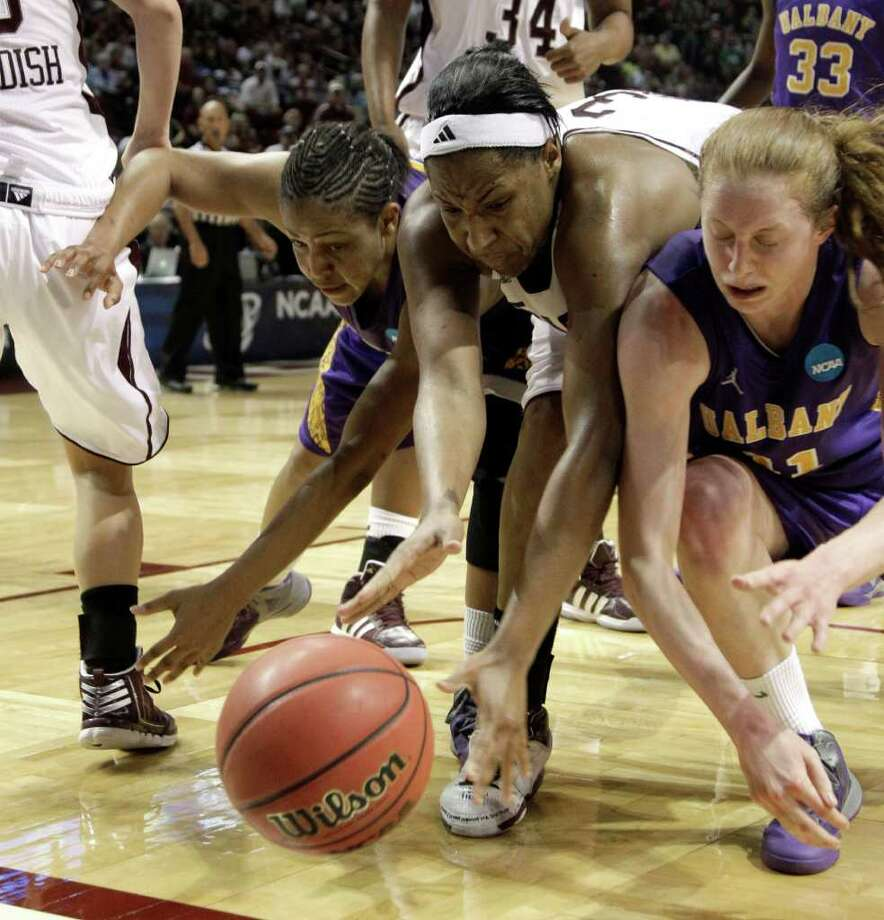 Albany's Ebone Henry, left, and Julie Forster (11) battle Texas A&M's Kelsey Bone (3) for a loose ball during the second half of an NCAA tournament first-round college basketball game on Saturday, March 17, 2012, in College Station, Texas. Texas A&M defeated Albany 69-47.  (AP Photo/David J. Phillip) Photo: David J. Phillip