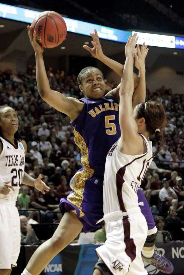 Albany's Ebone Henry (5) goes up for a shot as Texas A&M's Alexia Standish (10) defends during the second half of an NCAA tournament first-round college basketball game on Saturday, March 17, 2012, in College Station, Texas. Texas A&M defeated Albany 69-47. (AP Photo/David J. Phillip) Photo: David J. Phillip