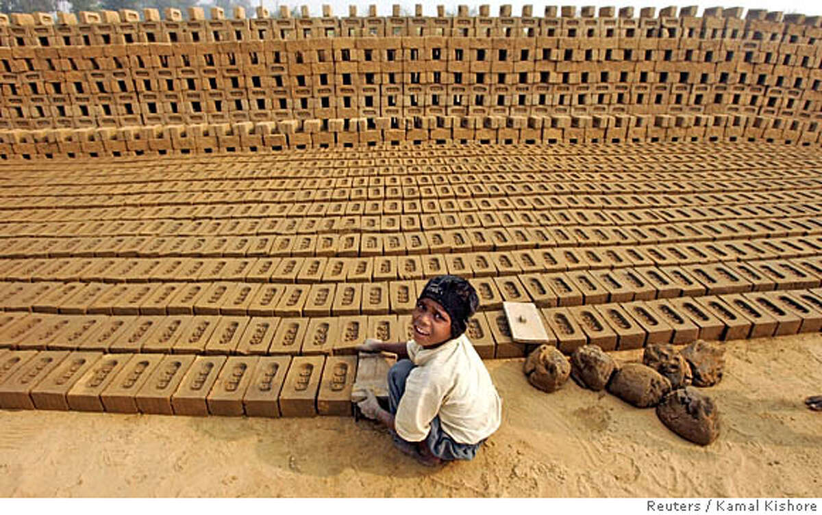 An Indian child makes bricks at a brick kiln unit near Bahadurgarh in the northern state of Haryana, December 30, 2005. Acceleration in economic growth has made India amongst the 10 fastest growing developing countries. Yet, about 30 percent of India's more than one billion people live below the official poverty line of 2,100-2,400 calories a day. REUTERS/Kamal Kishore 0