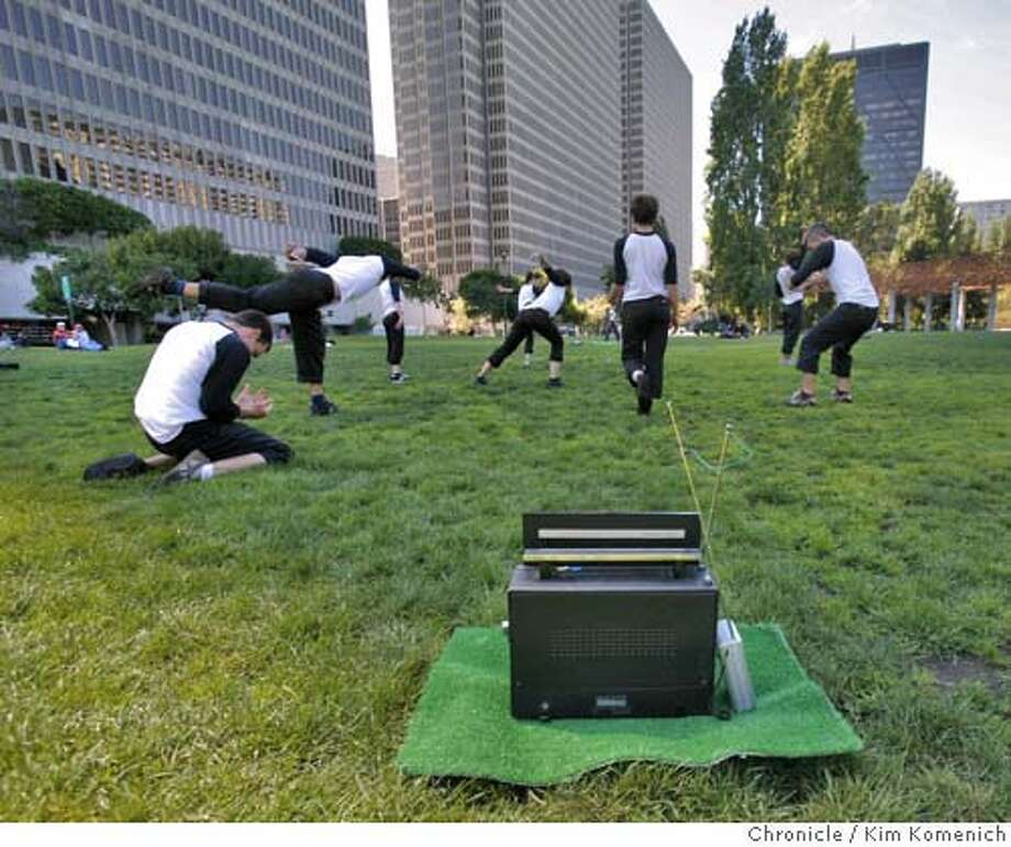 """BLACK_181_KK.JPG  A series of radios tuned to a short-range FM transmitter provide the soundtrack to Chris Black's dance """"Pastime"""" as it is performed on the lawn at Justin Herman Plaza Ferry Park. Photo by Kim Komenich/The Chronicle  **Chris Black Photo: Kim Komenich"""