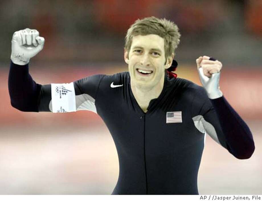 United States Joey Cheek, from Greensboro, N.C., celebrates his silver medal victory during the Winter Olympics men's 1,000 meter speedskating competition at the Oval Lingotto in Turin, Italy, Saturday, Feb. 18, 2006. (AP Photo/Jasper Juinen) Photo: JASPER JUINEN