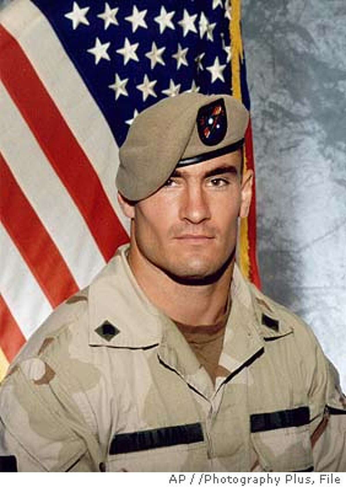** FILE ** Former Arizona Cardinals football player Pat Tillman, is shown in a June 2003 photo, released by Photography Plus. The New York Giants will face the Arizona Cardinals, Tillman's former team, when the NFL opens the 2005 season on Sept. 11, the first time pro football games have been played on that date since before the attacks. Tillman gave up a lucrative contract after the Sept. 11, 2001 terror attacks to join the Army with his brother, only to be killed in Afghanistan last year. (AP Photo/Photography Plus via Williamson Stealth Media Solutions) Ran on: 09-25-2005 Pat Tillman, who gave up a career in the NFL that would have made him a millionaire so he could instead fight terrorism as an Army Ranger, died from friendly fire in Afghanistan. Ran on: 09-25-2005 Pat Tillman, who gave up a career in the NFL that would have made him a millionaire so he could instead fight terrorism as an Army Ranger, died from friendly fire in Afghanistan.
