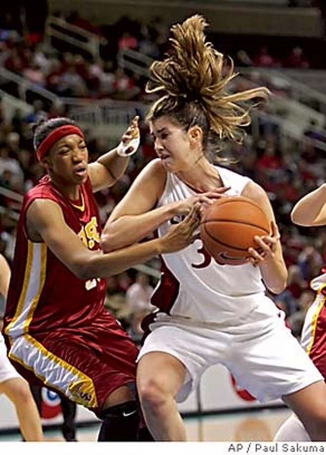 Stanford center Brooke Smith, right, is closely guarded by Southern Cal center Chloe Kerr, left, in the first half of the semifinals in the Pac-10 basketball tournament in San Jose, Calif., Sunday, March 5, 2006. (AP Photo/Paul Sakuma) Photo: PAUL SAKUMA