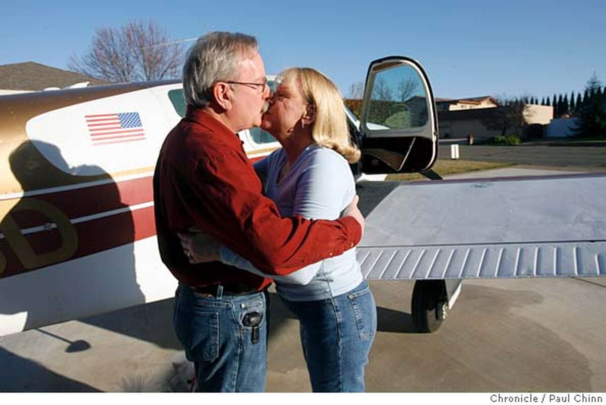 Burl Skaggs kisses his wife Carol before flying to his job in Palo Alto from their home at Cameron Park Airpark Estates residential community in Cameron Park, Calif. on 2/24/06 where the streets are taxiways, planes park in driveways and nearly every home comes with a hangar. PAUL CHINN/The Chronicle MANDATORY CREDIT FOR PHOTOG AND S.F. CHRONICLE/ - MAGS OUT