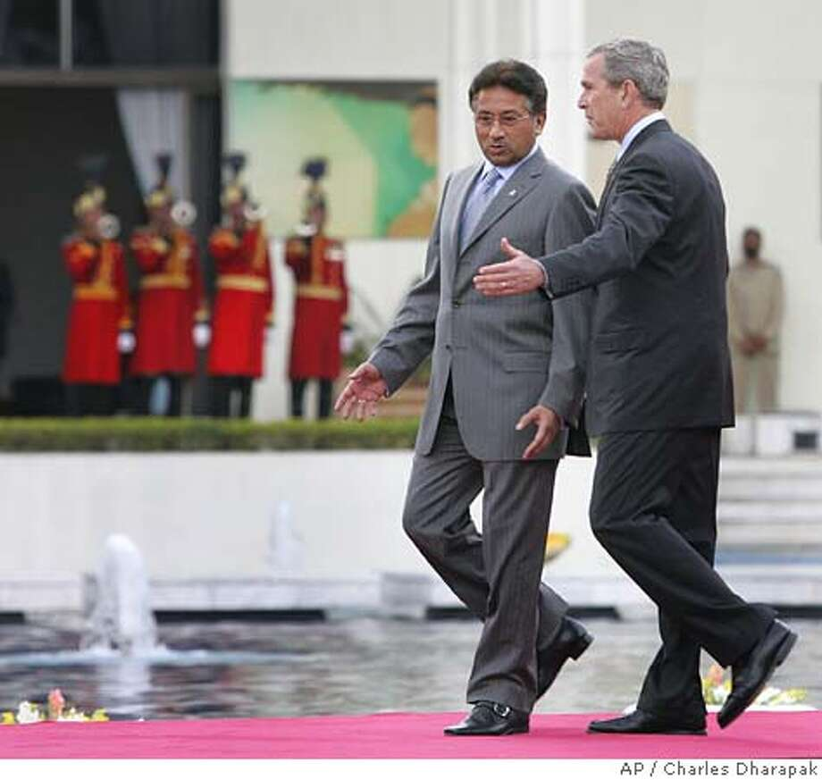 """U.S. President George W. Bush, right, and Pakistani President Pervez Musharraf walk together to a joint press availability at Aiwan-e-Sadr, or """"house of the President"""", in Islamabad, Pakistan, Saturday, March 4, 2006. President Bush showed solidarity Saturday with Pakistani President Gen. Perez Musharraf's war-on-terror alliance with the United States, a stance that is at odds with many in this Islamic nation. (AP Photo/Charles Dharapak) Photo: CHARLES DHARAPAK"""