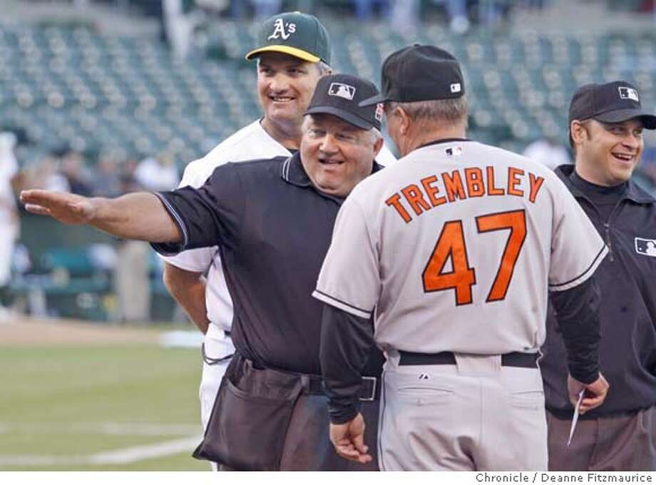froemming_0122_df.jpg  Bruce Froemming, jokes with Athletics manager Bob Geren at left and Orioles manager Dave Trembley at the start of the game. Umpire Mark Wegner is at right. He is in Oakland to umpire behind homeplate in Oakland Athletics game against the Baltimore Orioles, and will be retiring as a Major League Baseball umpire at the end of this season. Photographed in Oakland on 7/20/07. Deanne Fitzmaurice / The Chronicle Mandatory credit for photographer and San Francisco Chronicle. No Sales/Magazines out. Photo: Deanne Fitzmaurice