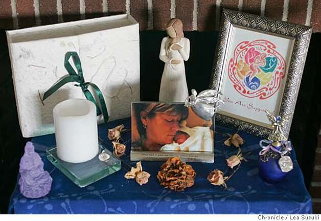 Close up of the altar dedicated to Avery. SLIDE SHOW to accompany Sunday March 5, magazine cover story and podcast on stillbirth. Suzanne Pullen shares part of her personal story and reports on the lack of research into cause of death, lack of standarized reporting of stillbirths and changing attitudes on the need for more bereavement support. The slide show, hopefully, will create a window into Suzanne's healing process by showing photos of her during her pregnancy, with her family and friends holding her son after he was stillborn at the hospital and the artwork and momentos she and friends have created in the year since his death. So many parents say they had no idea what to do or how to cope after the learned their child had died...many say they wish they had more (or any) photos, did a memorial or had held their child. We need photos of the artwork, memorial box, and altar that Suzanne has in honor of her stillborn son. Photo taken on 2/19/06 in San Francisco, CA. Photo by Lea Suzuki/ The San Francisco Chronicle Photo: Lea Suzuki