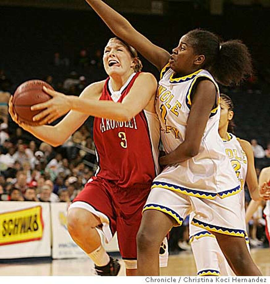 Appel drives against Pinole Valley's De Nesha Stallworth for 2 of 24 points. Chronicle photo by Christina Koci Hernandez