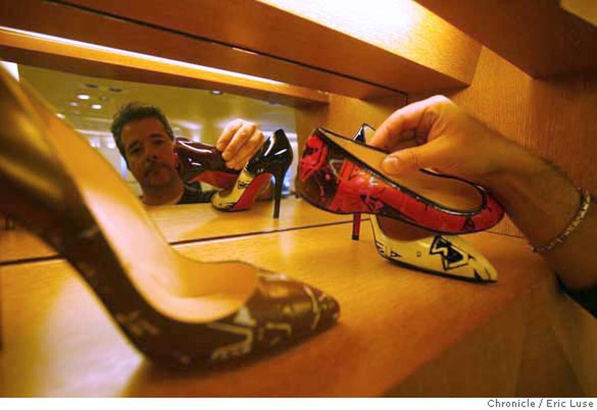 barneys16_0299.JPG Carlos Castillo, Salon Shoe Manager, adjusts a pair of Christian Louboutin shoes on display. Barney's Department Store is opening near Union Square in San Francisco. Photographer: Eric Luse / The Chronicle Names cq from source Edyta Dunwood Richard Canciamilla Christian Louboutin Carlos Castillo MANDATORY CREDIT FOR PHOTOG AND SF CHRONICLE/NO SALES-MAGS OUT