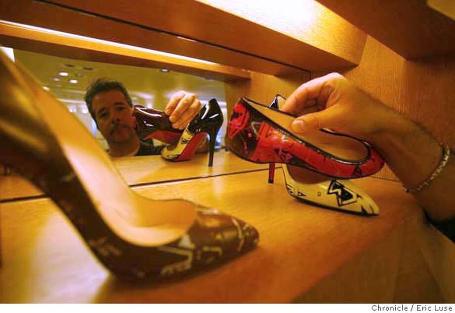 barneys16_0299.JPG  Carlos Castillo, Salon Shoe Manager, adjusts a pair of Christian Louboutin shoes on display.  Barney's Department Store is opening near Union Square in San Francisco. Photographer:  Eric Luse / The Chronicle Names cq from source  Edyta Dunwood  Richard Canciamilla  Christian Louboutin  Carlos Castillo MANDATORY CREDIT FOR PHOTOG AND SF CHRONICLE/NO SALES-MAGS OUT Photo: Eric Luse