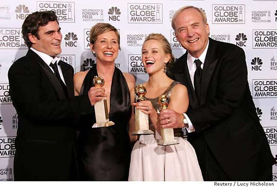 """Walk the Line"" producer James Keach (R), actress Reese Witherspoon (2nd R), producer Cathy Konrad (2nd L)and actor Joaquin Phoenix pose after the film won Best Motion Picture-Musical or Comedy at the 63rd Annual Golden Globe Awards in Beverly Hills, California January 16, 2006. Phoenix and Witherspoon also won for best actor and actress respectively for their roles in ""Walk the Line"". REUTERS/Lucy Nicholson Ran on: 01-17-2006  A &quo;Walk the Line&quo; lineup of, left to right, actor Joaquin Phoenix, producer Cathy Konrad, actress Reese Witherspoon and producer James Keach. 0 Photo: LUCY NICHOLSON"