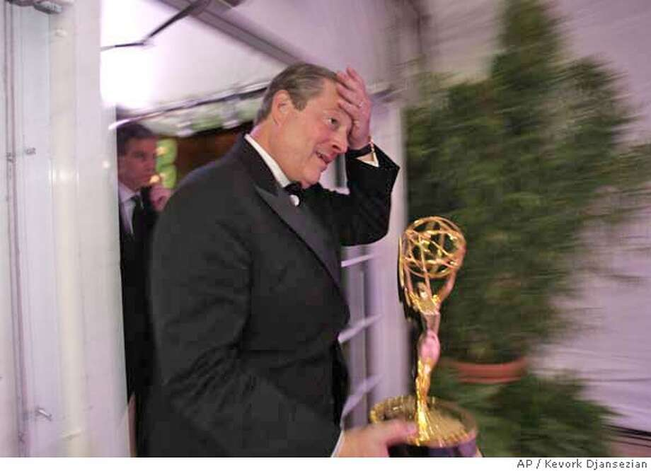 Al Gore reacts as he holds his outstanding interactive television award after picking it up from the trophy table at the 59th Primetime Emmy Awards Sunday, Sept. 16, 2007, at the Shrine Auditorium in Los Angeles. (AP Photo/Kevork Djansezian) Photo: Kevork Djansezian