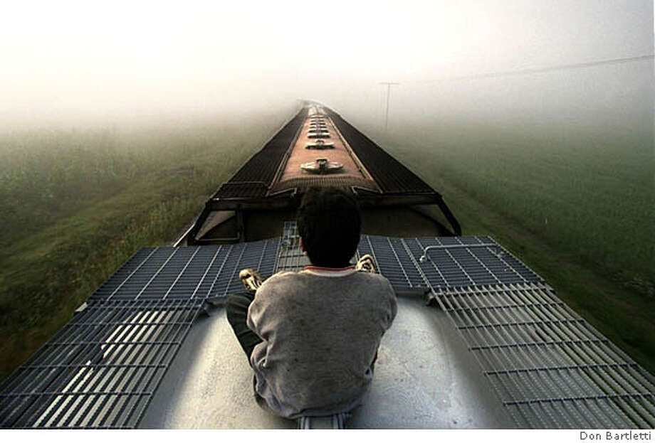 "Caption from the book, ""Enrique's Journey:"" A Central American youth rides a freight train through Mexico toward the United Staes. (more caption available in the book)  MUST CREDIT! ONE-TIME USE ONLY FOR BOOK REVIEW Photo: MUST CREDIT: Don Bartletti"