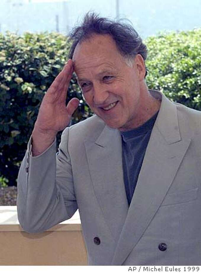 "HERZOG-C-12AUG02-DD-AP --- German director Werner Herzog gives a military salute to photographers during a photocall for this film ""Mein Liebster Feind"" (My Dear Enemy), out of competition, at the 52nd Cannes Film Festival in Cannes, France, Sunday, May 16, 1999.(AP PHOTO/Michel Euler) Ran on: 01-29-2005  Werner Herzog CAT Photo: X"