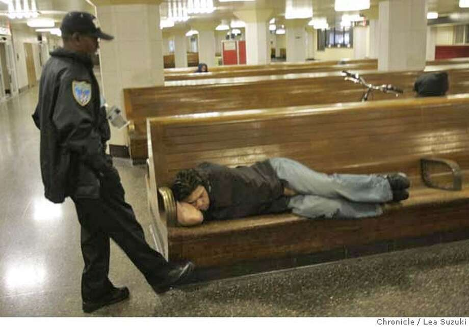 nevius18_006_ls.JPG  Patrol Officer Captain John Dunn taps a bench to wake up a person sleeping in the waiting room in the downstairs of the Transbay Transit Terminal. Security guards asking people to sit up and not lay down in the downstairs waiting room at the Transbay Transit Terminal. Nevuis is doing column on homeless sleeping at the Transbay Transit Terminal. Photo by Lea Suzuki/The Chronicle  Photo taken on 9/17/07, in San Francisco, CA.nevius18_006_ls.JPG Security guards asking people to sit up and not lay down at the Transbay Transit Terminal. Nevuis is doing column on homeless sleeping at the Transbay Transit Terminal. Photo by Lea Suzuki/The Chronicle  Photo taken on 9/17/07, in San Francisco, CA. �2007, San Francisco Chronicle  MANDATORY CREDIT FOR PHOTOG AND SAN FRANCISCO CHRONICLE/NO SALES-MAGS OUT Photo: LEA SUZUKI
