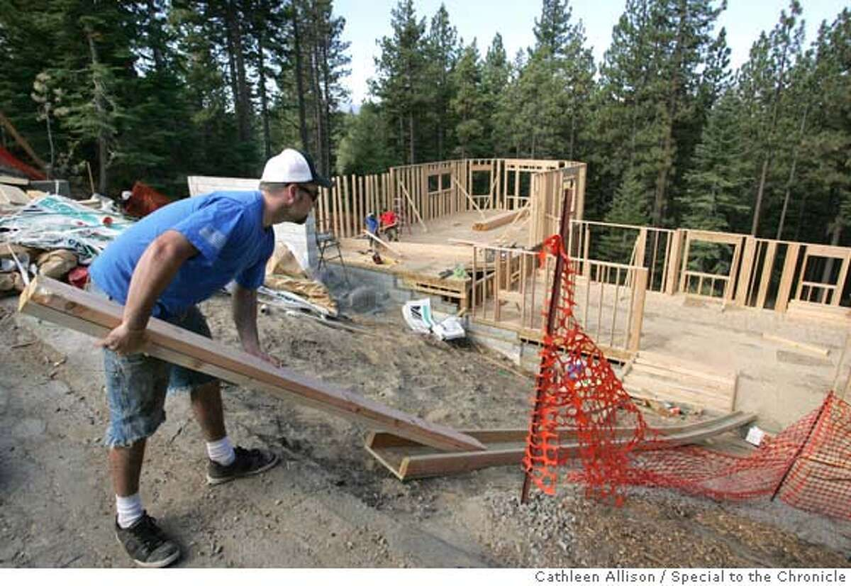 Matt Jones, of Matt Jones Construction, works on a 5,700 square-foot vacation home along Del Norte Street in South Lake Tahoe, Ca. on Monday, Sept. 17, 2007. Dense forest and steep slopes are concerns for experts who study high-risk development in the Sierra. Photo by Cathleen Allison/