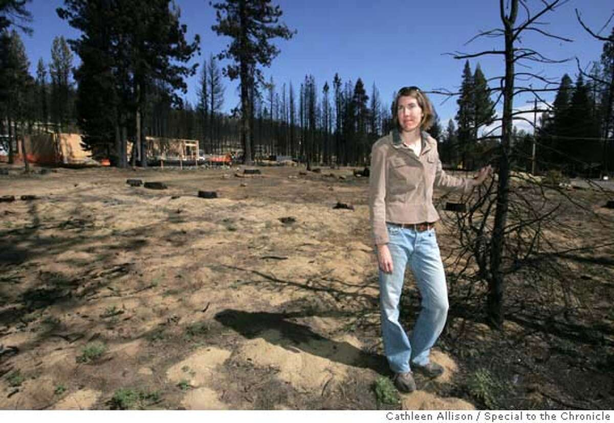 Autumn Bernstein, land use program director for Sierra Nevada Alliance, stands near a home being reconstructed on Mule Deer Circle in South Lake Tahoe, Ca, on Monday morning, Sept. 17, 2007. Bernstein recently completed a two-year study on the dangers of development in the heavily forested areas in the Sierra. The home was destroyed earlier this summer by the Angora fire. Photo by Cathleen Allison/