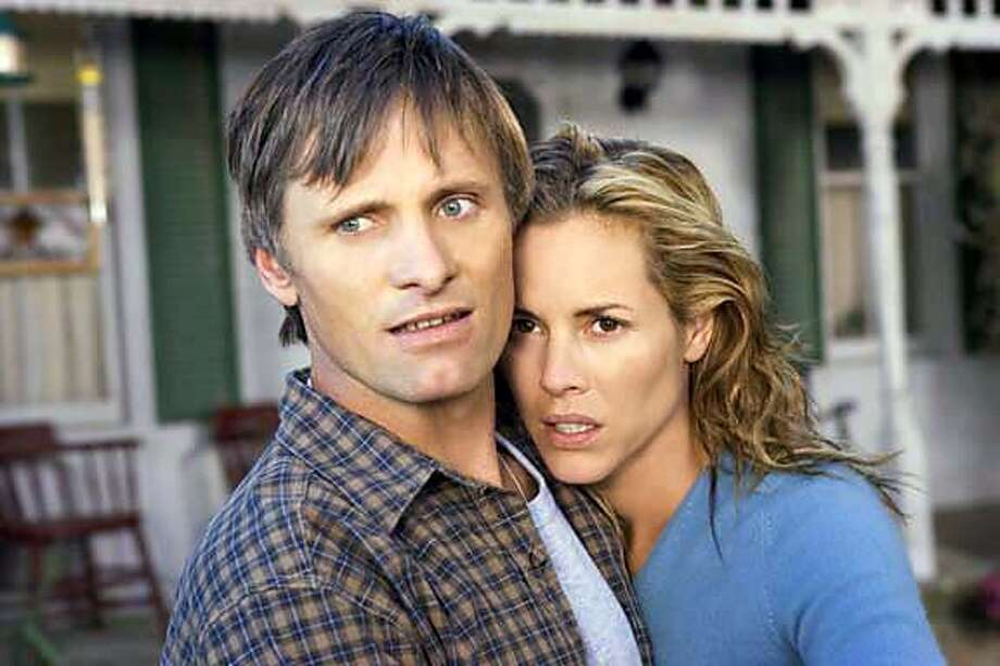 "HISTORY23 ""Tom Stall""(Viggo Mortensen) and his wife ""Edie Stall""(Maria Bello) have unexpected visitors in New Line Cinema�s thriller A History of Violence. March 1, 2005  Photo by Takashi Seida/newline.wireimage.com Ran on: 09-23-2005  Viggo Mortensen and Maria Bello play a passionate husband and wife in &quo;A History of Violence.&quo; ALSO Ran on: 11-06-2005  Creativity Explored artist Douglas Sheran's work. Photo: Takashi Seida"