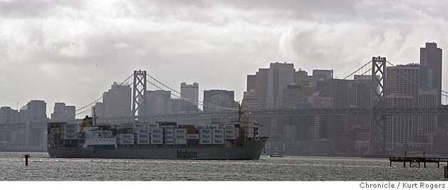 A container ship heads out under the bay bridge  The International Longshore and Warehouse Union is launching a campaign to reduce air pollution at West Coast ports. Its members are exposed to it at work and in the nearby communities where they live, and other people in those communities also suffer the consequences.  Kurt Rogers Oakland SFC  The Chronicle POLLUTIONXX_00056_kr.JPG MANDATORY CREDIT FOR PHOTOG AND SF CHRONICLE/ -MAGS OUT Photo: Kurt Rogers