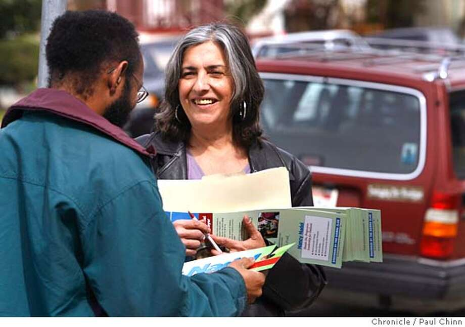 Oakland mayoral candidate Nancy Nadel chats with a supporter on Montgomery Street when she kicked off her campaign by walking a precinct and meeting with voters in Oakland, Calif. on 3/4/06.  PAUL CHINN/The Chronicle MANDATORY CREDIT FOR PHOTOG AND S.F. CHRONICLE/ - MAGS OUT Photo: PAUL CHINN