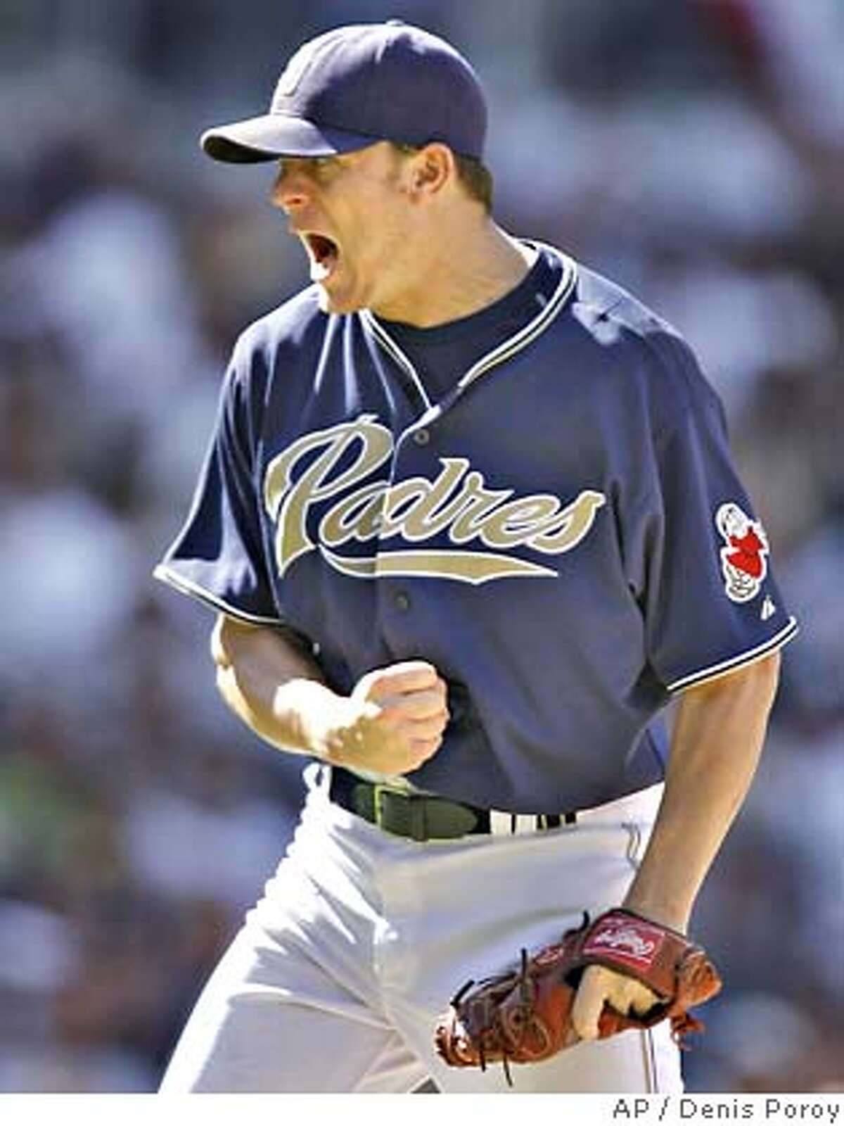 San Diego Padres pitcher Jake Peavy reacts after throwing a strike during the eighth inning of a baseball game against the San Francisco Giants Sunday, Sept. 16, 2007 in San Diego. The Padres won 5-1. (AP Photo/Denis Poroy)