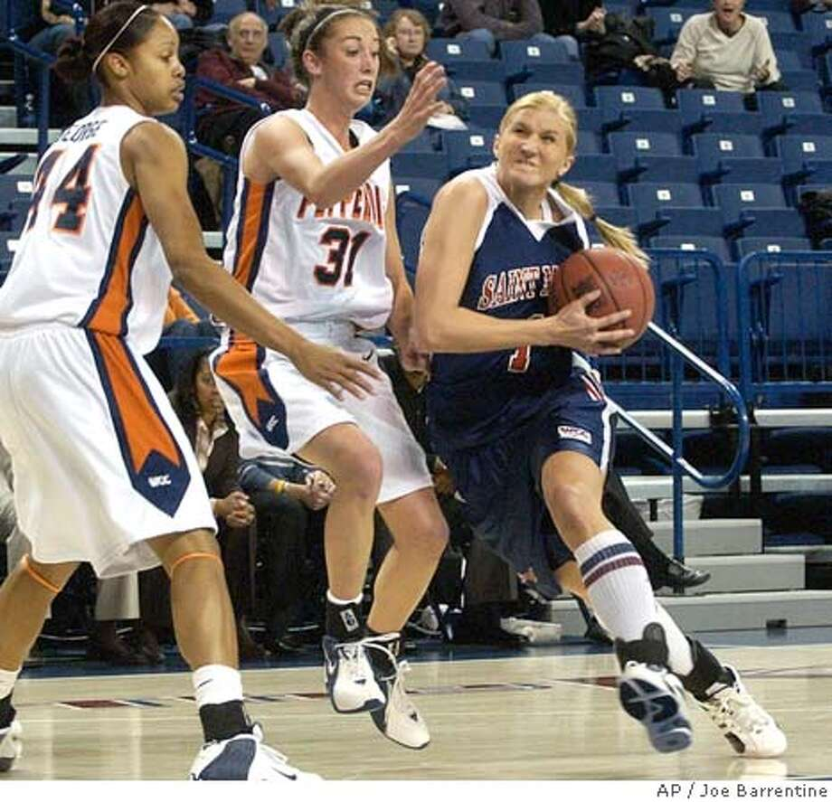 St. Mary's Maija Lahde, right, drives past Pepperdine's Jessica Ross, center, and Teiosha George in first half of the first round of the WCC Basketball Tournament in Spokane, Wash., Thursday March 2, 2006. (AP Photo/Joe Barrentine) Photo: JOE BARRENTINE