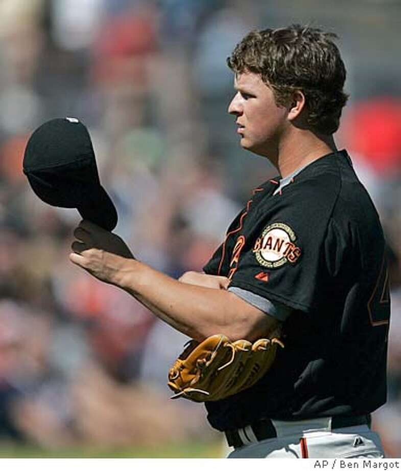San Francisco Giants' Matt Cain removes his cap as he waits to pitch to the Milwaukee Brewers during the second inning of a baseball spring training game Friday, March 3, 2006, in Scottsdale, Ariz. (AP Photo/Ben Margot) Photo: BEN MARGOT