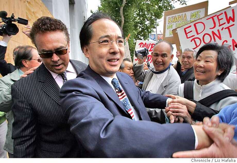 EDJEW17_028_LH_.JPG San Francisco Supervisor Ed Jew being greeted by supporters before being arraigned in SF Superior Court this morning on nine felony charges filed in relation to questions about whether he lived in the city when he voted and ran for public office. Behind him is his lawyer Bill Fazio. Liz Hafalia/The Chronicle/San Francisco/7/16/07  **Ed Jew, Bill Fazio cq Ran on: 07-18-2007  Ed Jew  Ran on: 07-18-2007 Photo: Liz Hafalia
