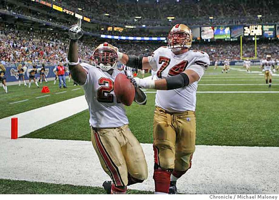 San Francisco 49ers Frank Gore (#21) and San Francisco 49ers Joe Staley (#74) celebrate Gore's 3rd quarter TD. The St Louis Rams host the San Francisco 49ers at Edward Jones Dome on 9/16/07 in St Louis, MO. The SF 49ers won 17-16.  Photo by Michael Maloney / San Francisco Chronicle  ***roster/code replacement MANDATORY CREDIT FOR PHOTOG AND SF CHRONICLE/NO SALES-MAGS OUT Photo: Michael Maloney