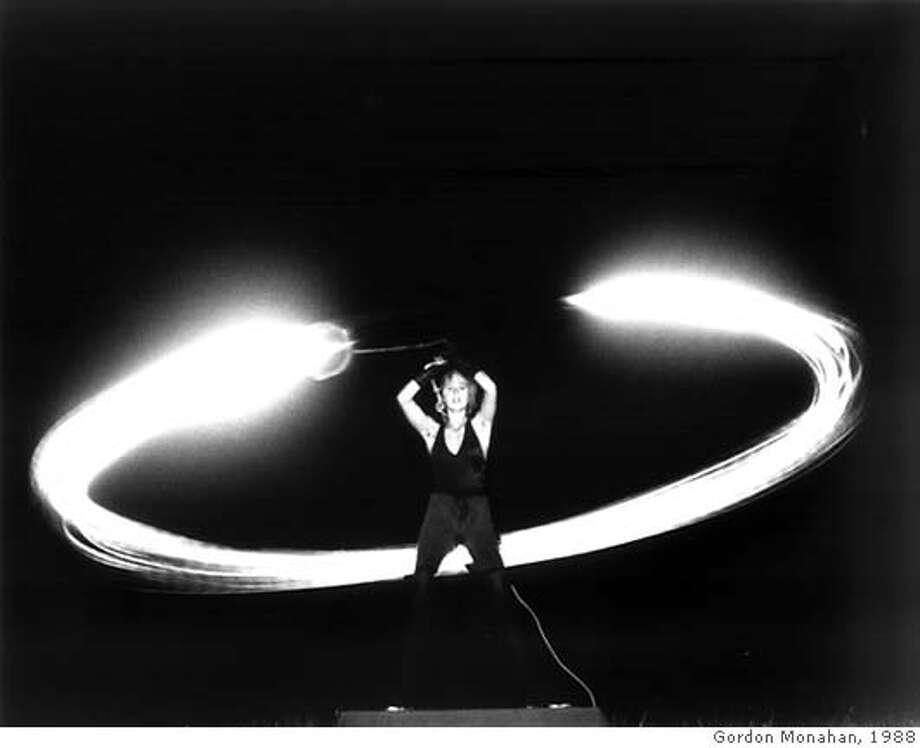 Laura Kikauka swinging in performance, 1988. Credit: Gordon Monahan Photo: Gordon Monahan