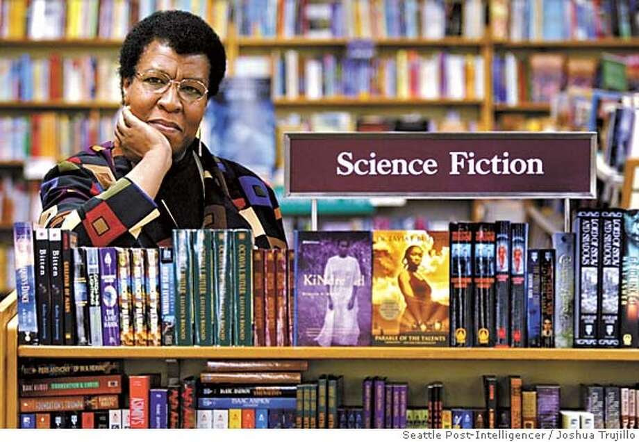 Science Fiction writer Octavia Butler poses for a photograph near some of her novels at University Book Store in Seattle, Wash., on Feb. 4, 2004. Butler, considered the first black woman to gain national prominence as a science fiction writer, died Friday, Feb. 24, 2006, after falling and striking her head on the cobbled walkway outside her Seattle home, a close friend said. She was 58. (AP Photo/ Seattle Post-Intelligencer, Joshua Trujillo) *** SEATTLE TIMES OUT *** Photo: JOSHUA TRUJILLO