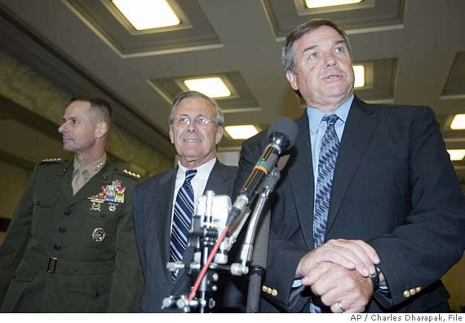 ** FILE ** Chairman of the House Armed Services Committee Rep. Duncan Hunter, R-Calif., seen in this May 18, 2004, file photo with Defense Secretary Donald Rumsfeld, center, and Vice Chairman of the Joint Chiefs of Staff Gen. Peter Pace, left, confirmed his opposition to the Sept. 11 Bill, Monday Nov. 22, 2004, and echoed Pentagon concerns that the realignment of intelligence authority could interfere with the military chain of command and endanger troops in the field. (AP Photo/Charles Dharapak/File) MAY 18, 2004 FILE PHOTO Ran on: 12-04-2004  Rep. Hunter Ran on: 05-19-2005  Rep. Duncan Hunter, chair of the armed services panel, opposes putting women in combat units. Ran on: 05-19-2005  Rep. Duncan Hunter, chair of the armed services panel, opposes putting women in combat units. Nation#MainNews#Chronicle#12/4/2004#ALL#5star##0422481197 Photo: CHARLES DHARAPAK