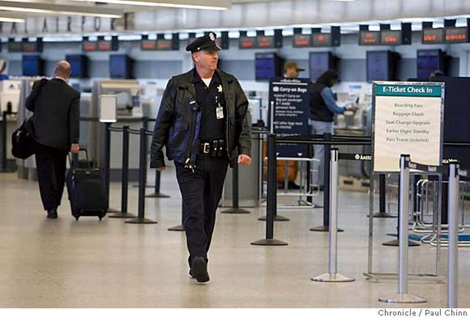 Oakland police officer Koch (who declined to give out his first name) patrols the terminal at Oakland International Airport on 3/1/06. With homicides in Oakland threatening to spiral out of control and residents complaining about slow responses to calls for help mayor Jerry Brown and police chief Wayne Tucker announce they will immediately redeploy 27 police officers to street patrols. Most will be reassigned from the airport security detail.  PAUL CHINN/The Chronicle MANDATORY CREDIT FOR PHOTOG AND S.F. CHRONICLE/ - MAGS OUT Photo: PAUL CHINN
