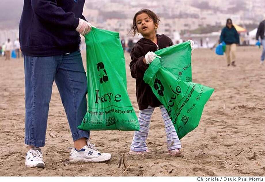 SAN FRANCISCO, CA - SEPTEMBER 15: Tejal Patel, 4 of San Jose joins in with hundreds of people as they clean the beach at Ocean Beach September 15, 2007 in San Francisco, California. (Photo by David Paul Morris/The Chronicle) Photo: David Paul Morris