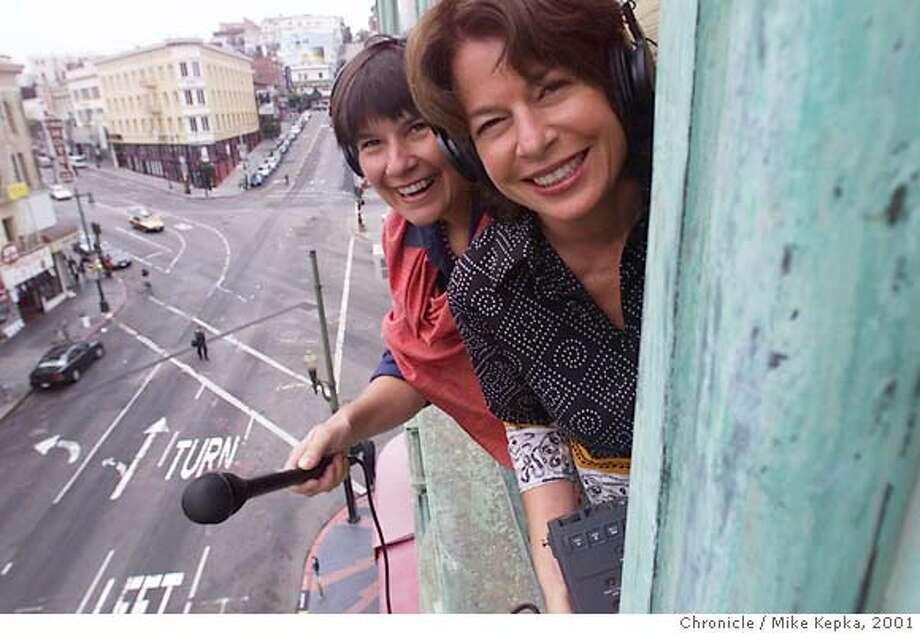 "KITCHENSIS-C-14AUG01-MG-MK - The Kitchen Sisters, Nikki Silva and Davia Nelson, Producers of the public radio project called ""Lost and Found Sound"" hang out the window of their San Francisco office. BY MIKE KEPKA/THE CHRONICLE Ran on: 12-26-2004  The Kitchen Sisters, the Peabody Award-winning, San Francisco radio documentary team of Nikki Silva (left) and Davia Nelson, have a new CD out, &quo;Lost & Found Sound and Beyond.&quo; Photo: MIKE KEPKA"
