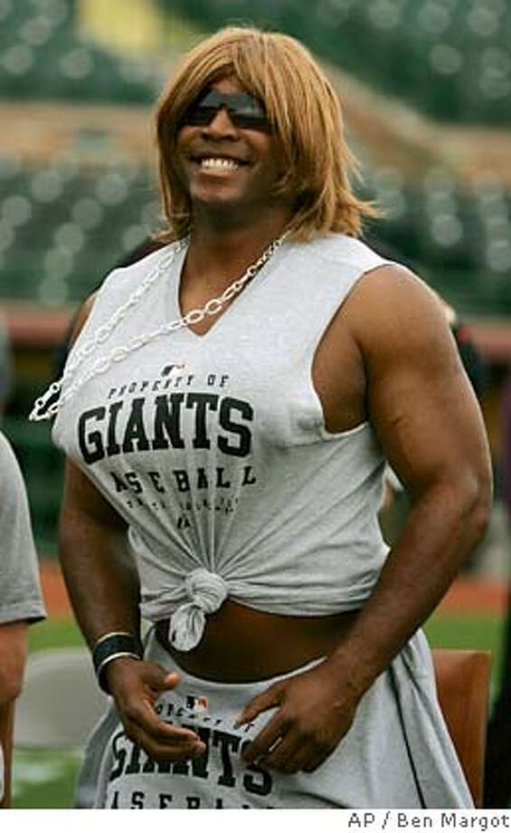 "Dressed in drag portraying Paula Abdul on ""American Idol"", San Francisco Giants' left fielder Barry Bonds participates in a rookie hazing spoof of the hit television show prior to a baseball spring training workout Wednesday, March 1, 2006, in Scottsdale, Ariz. (AP Photo/Ben Margot) EFE OUT Photo: BEN MARGOT"