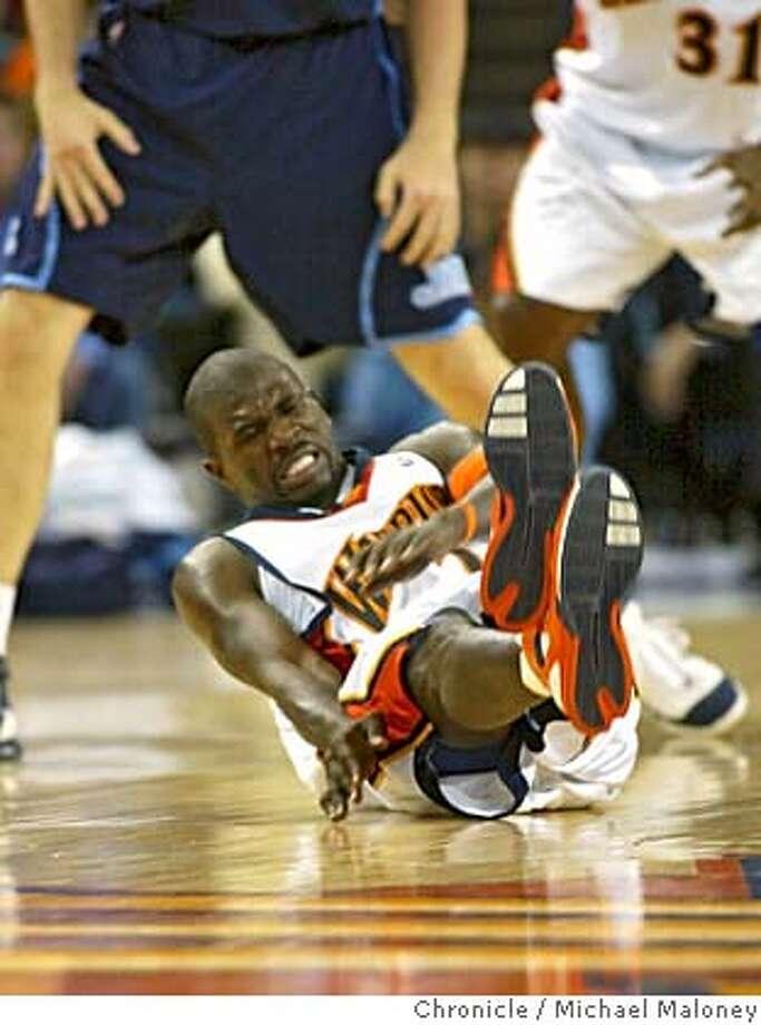 WARRIORS_348_MJM.jpg  Jason Richardson goes down in OT.  Golden State Warriors vs Utah Jazz at The Arena.  Photo by Michael Maloney / San Francisco Chronicle on 2/27/06 in Oakland,CA Photo: Michael Maloney