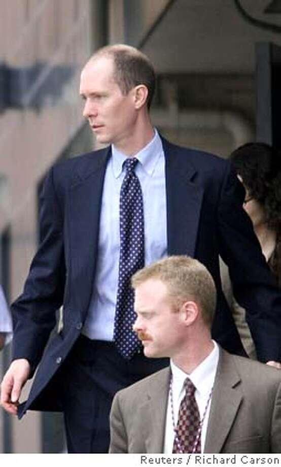 Former Enron trader and prosecution witness Belden leaves the Federal Courthouse in Houston Photo: RICHARD CARSON