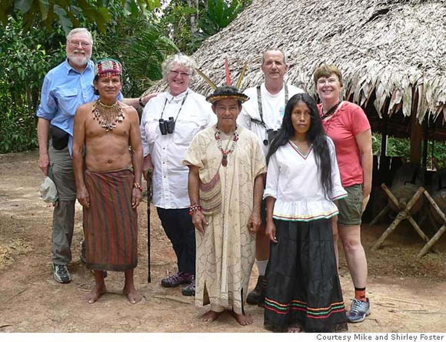 TRAVEL JUSTBACK -- Shirley and Mike Foster, Ferndale, CA Email: msfoster@frontiernet.net  Daytime phone number: 707-786-4977 Just back from: Amazon river trip, west from Iquitos, Peru I went because: We wanted to explore the rain forest that Michael had taught about for many years, but had never seen. Don't miss: Dug-out canoe trips up the black water creeks that flow deep into the thick rain forest. Birds, monkeys, pink river dolphins, fish abound Don't bother: Packing anything dressy or fancy. Coolest souvenir: Amazing little purses made from native plants and seeds; carved gourd purses Worth a splurge: It's difficult to find anything or place that qualifies as being splurge in the rain forest. I wish I'd packed: A long, loose cotton skirt for nights on board. Other comments: Baseball caps, hair clips, and tennis balls make great gifts for the locals... Details of attached photo (if sent): back f. left: Mike & Shirley Foster; Gary & Ruthanne Rocha  front: center: Guillermo, shaman; sides: Juan & Carola, apprentice shamans 8/27/07 in , . Ran on: 09-16-2007  Travelers Mike and Shirley Foster (back row, from left) and Gary and Ruthanne Rocha pose with shaman Guillermo (center front) and his apprentices, Juan and Carola. Photo: NA