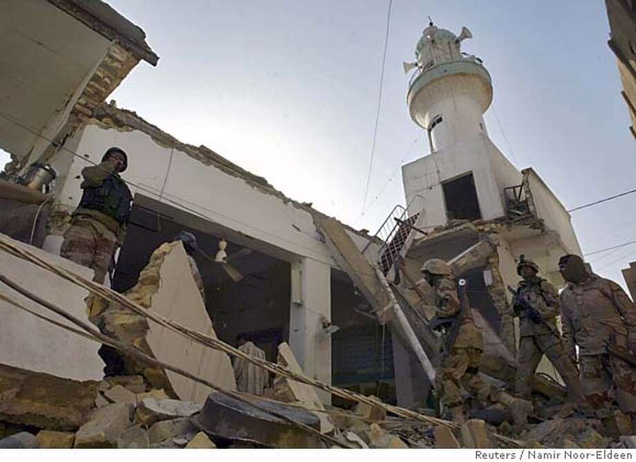 Iraqi soldiers walk among the rubble of the Sunni Hurriya mosque after it was destroyed by a bomb attack in Baghdad, February 28, 2006. Interior Ministry sources said a Sunni Arab mosque was damaged by a bomb early Tuesday morning. The attack came after the bombing of a Shi'ite shrine last week set off reprisals against Sunni targets and plunged Iraq into its deepest crisis since the fall of Saddam Hussein in 2003. REUTERS/Namir Noor-Eldeen 0 Photo: NAMIR NOOR-ELDEEN