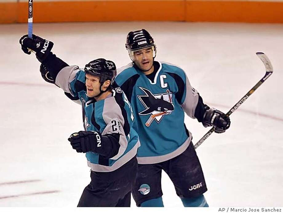 San Jose Sharks' Nils Ekman, of Sweden, left, celebrates with teammate Patrick Marleau after a first-period goal against the Detroit Red Wings during an NHL hockey game in San Jose, Calif. on Tuesday, Feb. 28, 2006. (AP Photo/Marcio Jose Sanchez) Photo: MARCIO JOSE SANCHEZ