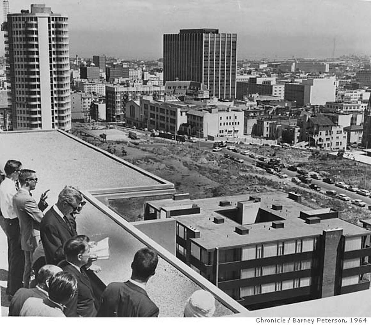 Planing and Redevelopment agency make inspection of new buildings from Laguna Eichler Apartments near Federal Building. Barney Peterson, Chronicle / Barney Peterson, 1964 Photographer