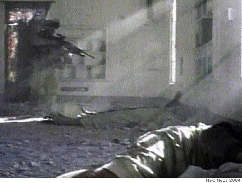 *RETRANSMITTED TO CHANGE SLUG AND REPLACE REFERENCE TO PRISONERS** ** FIRST IN A SEQUENCE OF FOUR IMAGES, EDS NOTE: CONTENT ** In this image taken from pool video provided to the Associated Press by NBC News, a U.S. marine is seen, left, raising his rifle in the direction of two wounded Iraqi men lying on the floor of a mosque in Fallujah, Iraq Saturday Nov. 13, 2004. The marine then fires his weapon, the bullet striking the upper body of one of the Iraqi men. The bodies of two other Iraqis are seen in the foreground, lower right. The pool video was recorded Saturday as the Marines returned to an unidentified Fallujah mosque. A Marine spokesman in Washington said the shooting was under investigation. (AP Photo/NBC News, Pool) Ran on: 11-21-2004  Margaret Hassan pleads for her life in a video made by her captors before they allegedly killed her last week. Ran on: 11-21-2004  Margaret Hassan pleads for her life in a video made by her captors before they allegedly killed her last week.