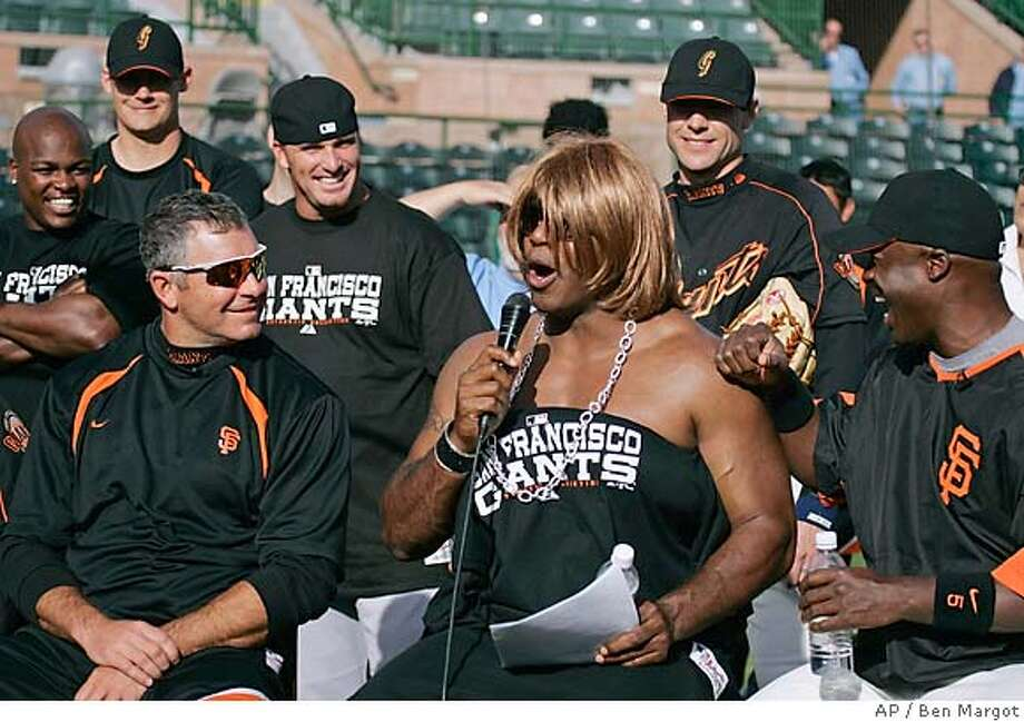 "Dressed in drag portraying Paula Abdul on ""American Idol"", San Francisco Giants' left fielder Barry Bonds, center, participates in a rookie hazing spoof of the hit television show beside pitcher Jeff Fassero, left, as Simon Cowell, and second baseman Ray Durham as judge Randy Jackson prior to a Major League baseball spring training workout Tuesday, Feb. 28, 2006, in Scottsdale, Ariz. (AP Photo/Ben Margot) Photo: BEN MARGOT"