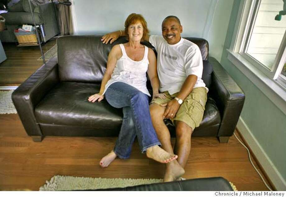 William and Joan Beverly, now 54 and 56, reaffirmed their vows in the same Berkeley church where they first married over 27 years ago. They are photographed on their couch in their Oakland home.  Photo taken on 8/22/07 in Oakland, CA  Photo by Michael Maloney / San Francisco Chronicle  ***William, Joan Beverly Photo: Michael Maloney